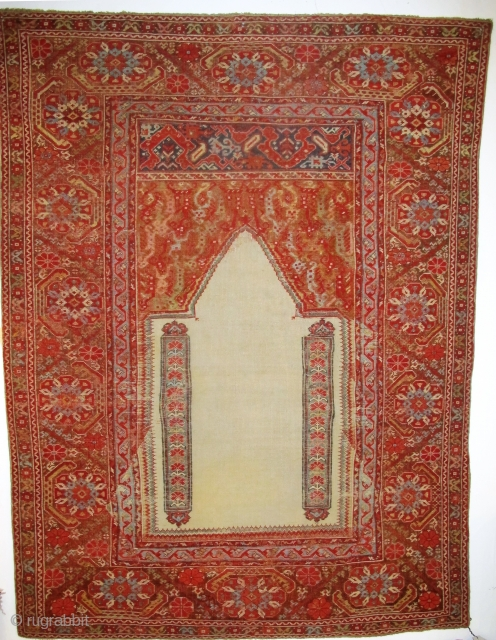 Giordes Prayer Rug, 1.71m x 1.28m, circa 1700, or earlier. Beautifully drawn elements, the design is perfectly balanced. Rare white field, funky spandrels and a really pretty main border. Note the lazy  ...
