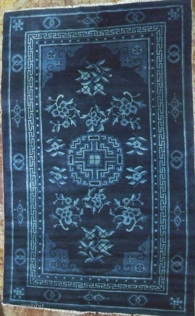 "Baotou Rug: Special offer- Classic Mongolian hall carpet incorporating the typical ""three blue"" color palette with abstract geometrical central floral medallion and auspicious Chinese flowers and symbols. Excellent condition- the fringe on  ..."