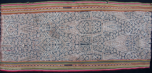 Iban woman's kain skirt from Sarawak depicting the tree of life with bamboo running the length of the bidang. There is some fraying on the selvedge, and a seamless repair noted in  ...