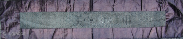Fine and rare early 20th century Miao baby carrying strap from Zhouxi, Guizhou China. Please note that every diamond shaped medallion pattern is different. This is woven from all handspun silk warp  ...