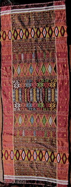 """Colorful hand woven beaded shoulder cloth from the Batak people, Sumatra. This piece is quiet lively and complicated with gold treads, and large """"Rasta"""" colored diamond patterned warp embroidered bands. The """"Dame  ..."""