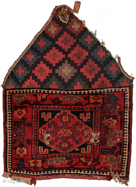 Pile khorjin recycled as saddle rug Kurds of the Sauj Bulagh area Northwest Persia Circa 1850 63 x 43 cm (25 x 17 in.)   Weaving Density:10 H x 8 V = 80 kpsi. Colours:maroon, pinkish red, apricot,  ...