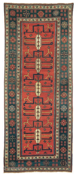 """Red ground Talish rug with cypresses and hooked motifs Southeast Caucasus circa 1830 237 x 102 cm (7'9"""" x 3'4"""")  Alg 1022 symmetrically knotted wool pile on a wool foundation  An extraordinary Talish rug distinguished by  ..."""