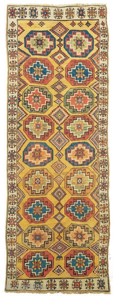 """Yellow ground long rug with coffered Memling guls Cappadocia East central Anatolia 18th century 324 x 115 cm (10'8"""" x 3'9"""")  Alg 1243 symmetrically knotted wool pile on a wool foundation Rugs of the yellow ground group have  ..."""