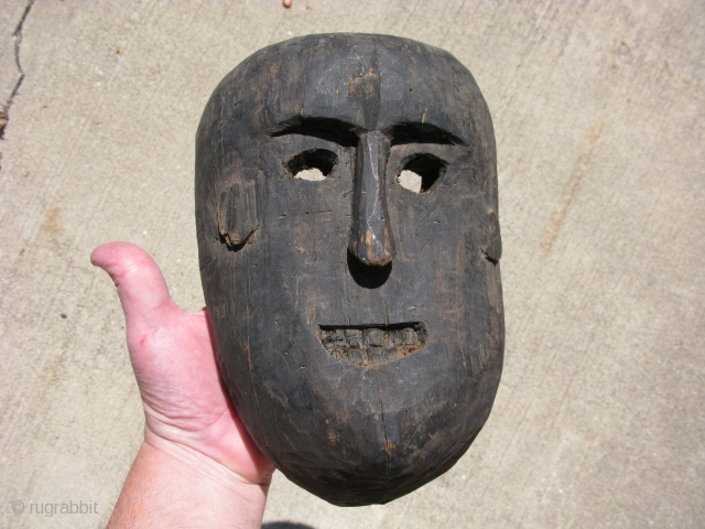 Vintage mask, hand carved wood with bared teeth, Atoni people of Timor, Southeast Asia, scuffs, a chip on the lower back, hairline cracks, stable, the approximate size is 9.5 inches tall, 6.5  ...