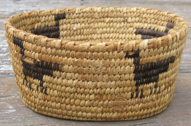 Old Native American basket, Tohono O'odham People, ( Papago Indians ), hand coiled yucca with designs in Devil's Claw, American Southwest, 2nd quarter 20thC, potentially older, it has the beautiful golden hue  ...