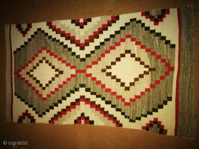 Antique Navajo rug. Condition is excellent. Size. 3/5 feet.