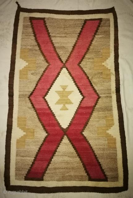 Handmade Navajo rug. Little work in on border corner. Size 4feet2inch by 2feet8inch.