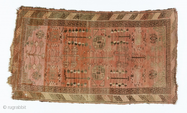 A Kyrgyz giliam, Chinese Turkestan, probably Aksu area, late 19th century, 270 by 147 cm, classical Kashgar design with elements borrowed from Turkoman rugs, a small figurines of a man, horse, camel  ...