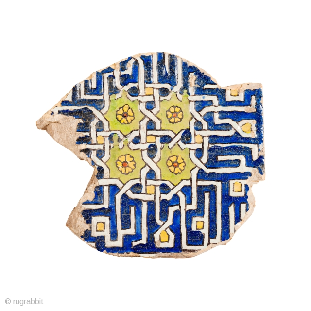 A fragment of cuerda seca pottery tile, decorated with four identical interlocking decorative inscriptions in square Kufic, لا إله إلا الله , the beginning of the shahada, 'There is no god but  ...