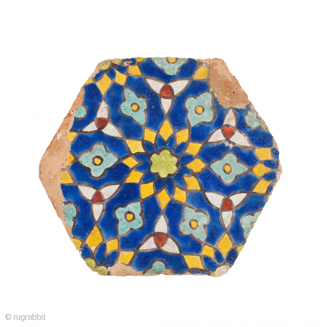 Timurid cuerda seca pottery tile, of hexagonal shape, moulded, decorated with polychrome rosettes and trefoil motifs, Samarkand, early 15th century, diam. 26.5 cm