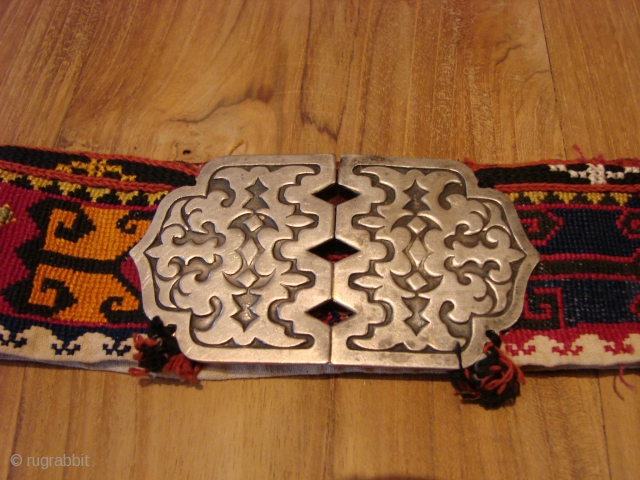 Embroidered belt with silver buckle.