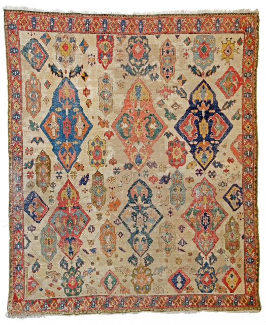 Lot #169, Azerbaidjan carpet, 8ft. 6in. x 7ft. (260 x 213 cm), Azerbaidjan 18th century, Condition: fair, even low pile, some staining to field, original ends and selvedge, few small spots of old repair, cotton warp, cotton  ...