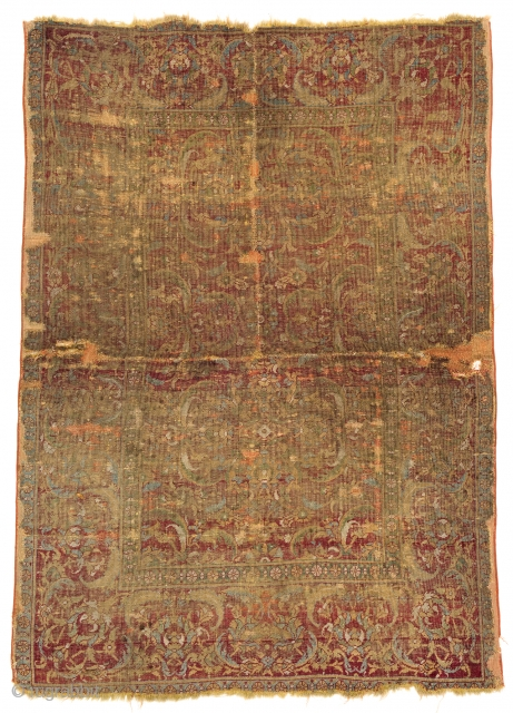 Lot 147, KAIRO FRAGMENT 177 x 126 cm (5ft. 10in. x 4ft. 2in.) Egypt, 16th century Condition: fragment, several repairs and age-related signs of use Warp: wool, weft: wool, pile: wool. 
