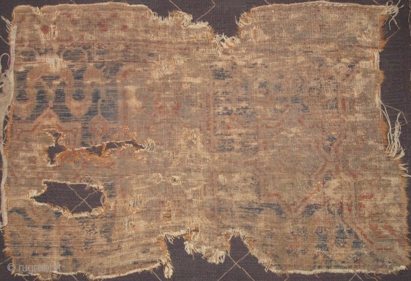 Ghostly border fragment with cloudbands and cartouches from a circa 1500 NW Persian carpet,either Aq Quyunlu (pre-Safavid) or Shah Ismail period. This is most likely from an early Tabriz area medallion carpet  ...