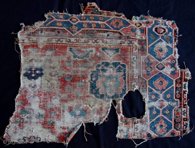 """Old Caucasian or perhaps Northwest Persian fragment so-called """" Golden Triangle """" region  with sylized cartouche borders, field reminiscent of older early harshang design. Nice rendition of small ewers."""