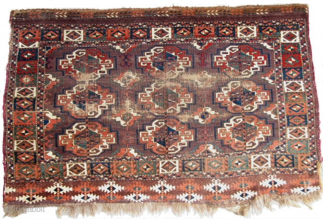 Chodor Chuval, large Turkmen bagface with large well-spaced chuval guls. Saturated madder-red abrash, greens, blue-greens, and slate blue.