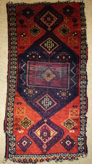 East Anatolian Kurdish yastik. This pieces uses several talismanic knots of either horse or possibly human hair in areas of the bottom. It has a severe border break at the bottom due  ...