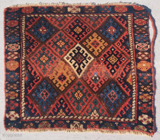 """Jaf Kurd bagface, 24""""x21, soft lustrous wool and saturated color with a single white elongated diamond in the center. There is a narrow band of old repair in the field which could  ..."""
