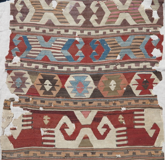 "Antique Central Anatolian kilim fragment, mounted and conserved, nice graphics and weave. 33"" x 108"". Traces of purple 'mosque ink' which seems to spell ""vakif""."