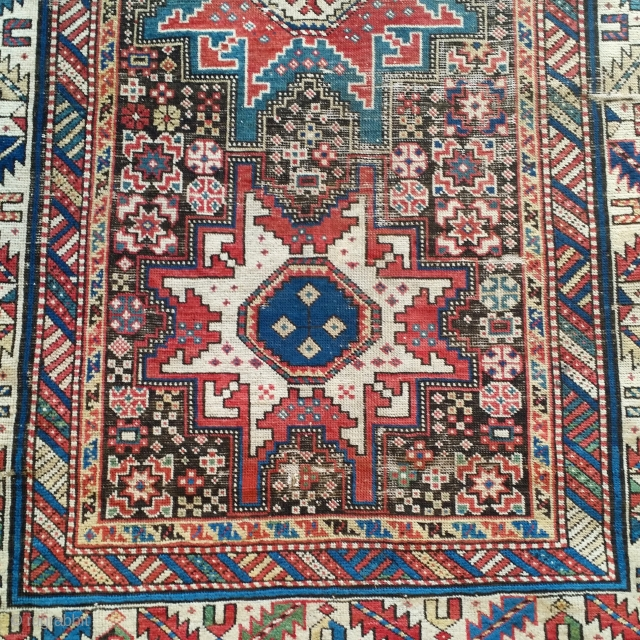 Shirvan rug with a Leshghi star design, very nicely drawn. Naturally corroded oxidized brown ground, scattered losses to side selvedge.