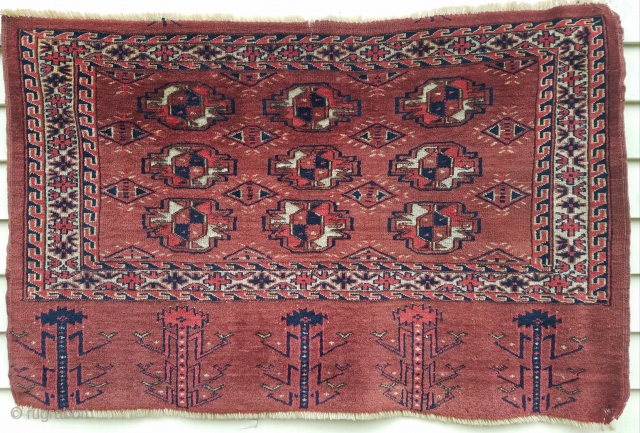 """Turkman nine gul chuval - about 44"""" x 29"""".  Evenly low pile, nice wool, interesting secondary guls and wonderful skirt.  Couple old mends."""