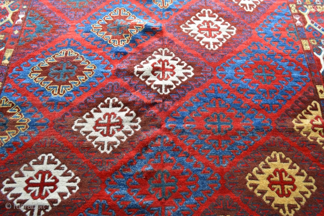 Rare Khirgyz carpet in square format. Good overall condition with some minor wear and brown-dye corrosion. 2.44m (8') square.