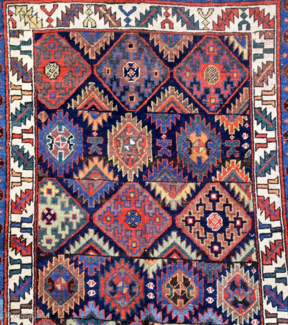 Antique Kurdish rug, 19th c. 128 x 242 cm. Upper end stripe rewoven. Spots of low pile. Corrosion to black. Great natural colors. Great look.