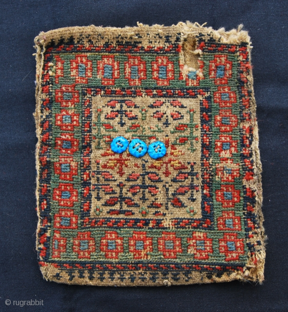 Northwest Persia(Khamseh of northwest Iran, north of Zanjan and south of Heriz, according to a rug scholar) small chanteh/personal bag. Cm 24x28. Sumack weave, with three glazed plaster buttons, (or ceramics?), in  ...