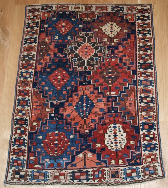 Antique Caucasian Kuba region rug with scarce design and very small size. http://www.knightsantiques.co.uk/530157/antique-caucasian-rug-of-small-size-and-scarce-design-kuba-region-late-19th-century/ Size: 4ft 3in x 3ft 2in (130 x 97cm).