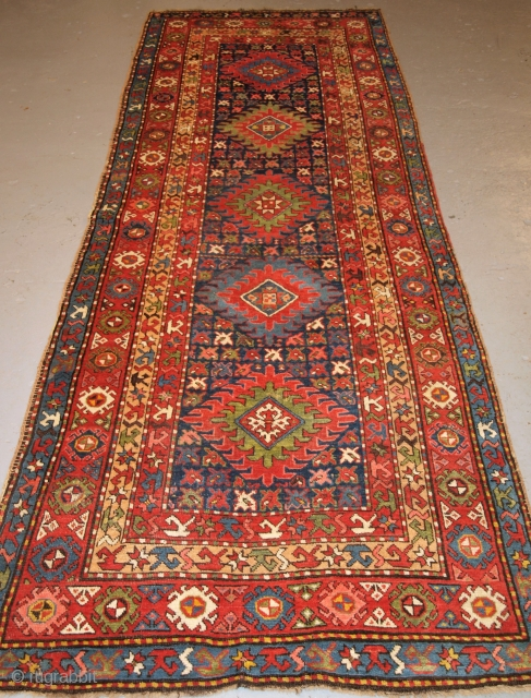 Antique Caucasian Long rug or runner with a repeat medallion design.