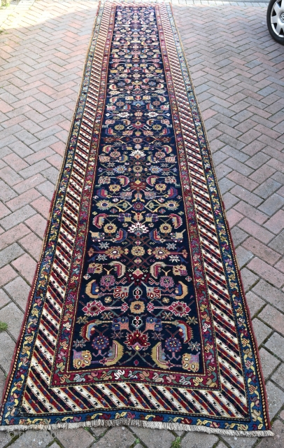 A good antique karabagh runner, circa 1880. Long, straight and narrow with good natural dyes, fine silky wool and attractive design. A classy piece in full pile. Slight losses to ends (secured),  ...