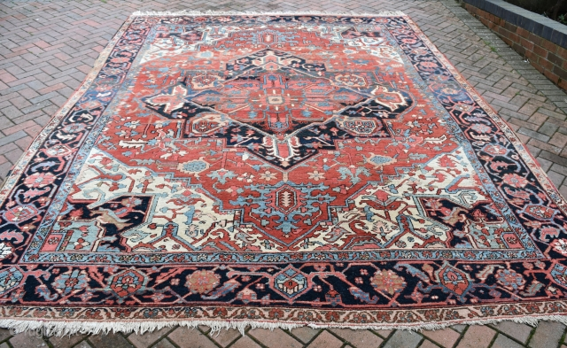 A good Heriz/Karaja carpet. Clear vegetable dyes in good original condition. A solid, clean carpet, washed and floor ready. 383x296cm. Circa 1900