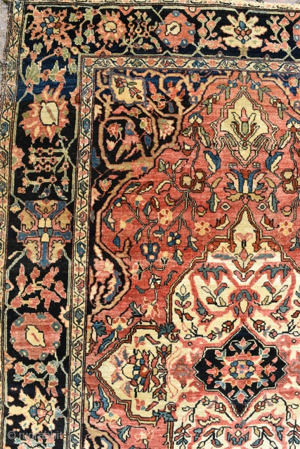 A fine antique Persian Sarouk rug, tightly knotted with some silk pile, a highly unusual feature. The piece has good age. Even low pile, slight nibbles to the ends and sides which  ...