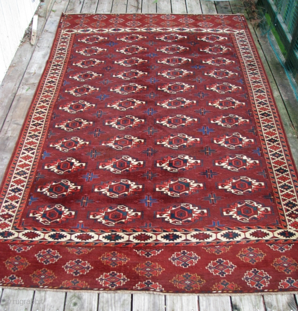 """Circa 1800, Early 19th Century  Yomut Main Carpet:   This beautifully drawn and spaced red brown field of this handsome Yomut """"family"""" main Carpet with four vertical and eleven horizontal  ..."""