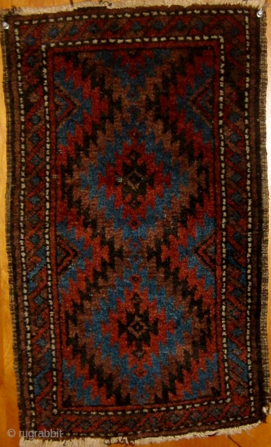 """Antique small Baluch balisht, circa 1900, all natural dyes including a wonderful light blue.  In good condition, soft silky wool,mostly full pile.  28"""" by 16"""".  Please ask for additional  ..."""