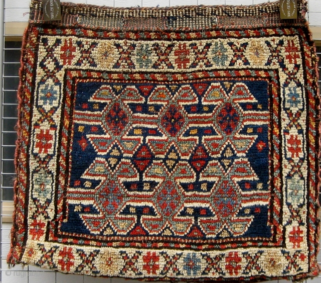 "NW Persian bagface with added flat woven back (probably not original), some tip fading, circa 1900, 20"" by 22""."