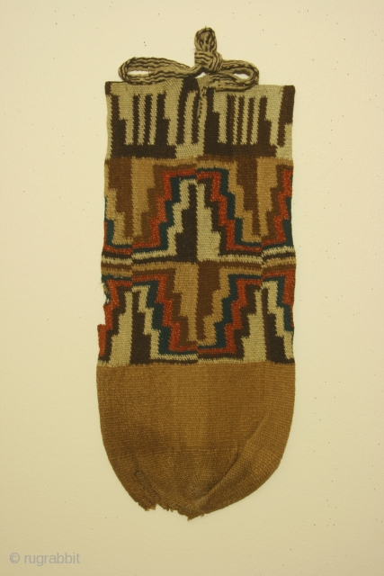 Pre-Columbian bag, Siguas 1 culture, Peru, circa 550 BC - 100 AD, Department of Arequipa,camelid fiber, interlocking discontinuous warp and weft, probably used as a quiver ( flechero) for arrows. Dimensions: 9  ...