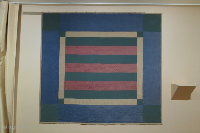Amish quilt with bars patterning, Lancaster County, PA, circa 1900, 73 x 78 inches, wool front, cotton lining on back. The quilting stiching is of very high quality.