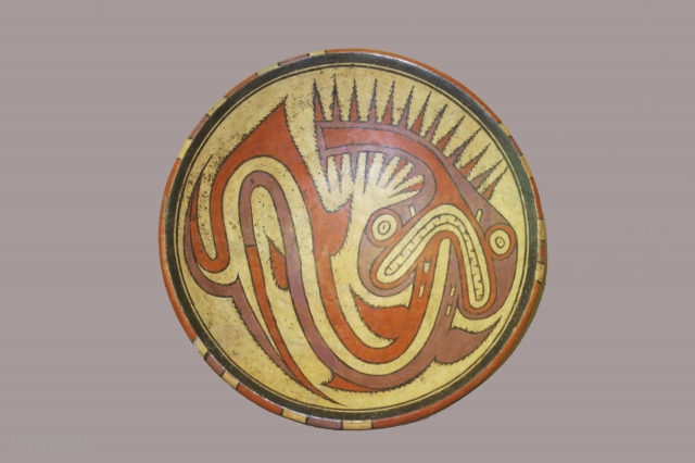 Panama, ceramic pedestal plate, Cocle culture, circa 800-1200AD, diameter 10 1/2 inches, foot 4 inches, depicting a sawfish-like creature/diety. Found broken in several pieces and restored ( no modern added pieces)