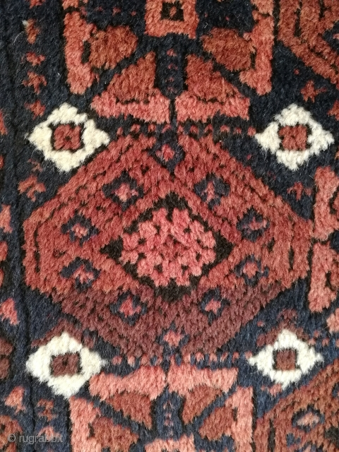 """Antique Balutch, Timuri, ca 1915  Technical summary  Object: Balutch nomad rug.   Manufacturing area: Khorrassan, most likely from the Torbat-I-Heidari area.   Pattern: """"Mina Khani"""" pattern. Diagonal stylized flowers and hexagons covers the midfield. S-boarder. """"Baluch  ..."""