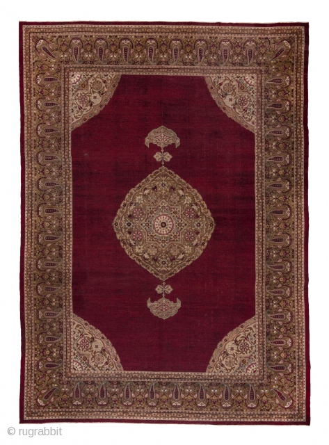 Amritsar Carpet  9.8 by 13.6 2.98 x 4.14  The deep wine red open field of this well-woven Indian  city carpet features aa scalloped ogival layered medallion with sharp pendants set within matching ivory corners.  ...