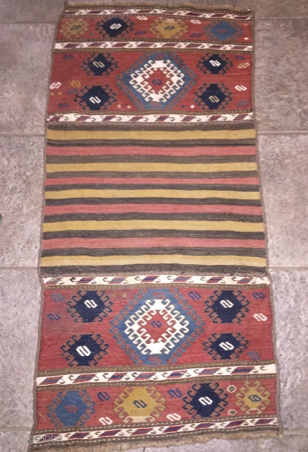 """Shahsavan soumac end panels salvaged from damaged mafrash and sewn to part of bottom to make a wall hanging. 3'5"""" X 1'9"""". 19th C. Wool.  Fine soumac in beautiful warm natural  ..."""