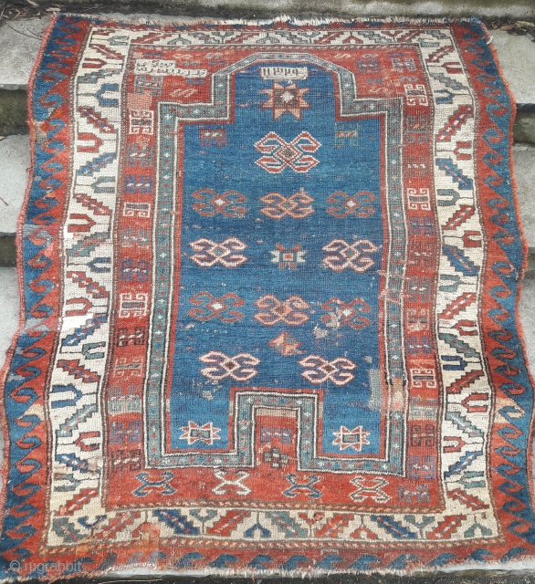 Dated kazak prayer rug, with condition issues, washed and conserved.