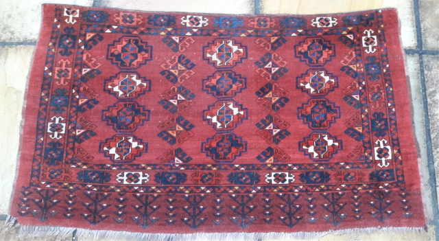 Late 19th-early 20th century Ersari chuval Full pile, minor losses to right lower corner, top edge over-bound, all colours good. 55in by 31in