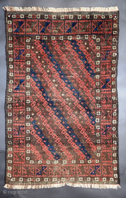 "Baluch rug, 32"" x 49"" (78 x 124 cm), symmetrical knotting, natural dyes with two shades of red, one being the more traditional tonality, the other with hints of raspberry and/or brown,  ..."