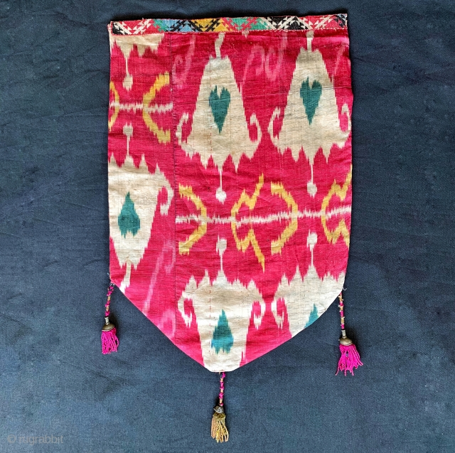 An excellent Antique 19th century Uzbek Adras quilted Ikat shield shaped hanging from Bokhara / Bukhara region. It is an