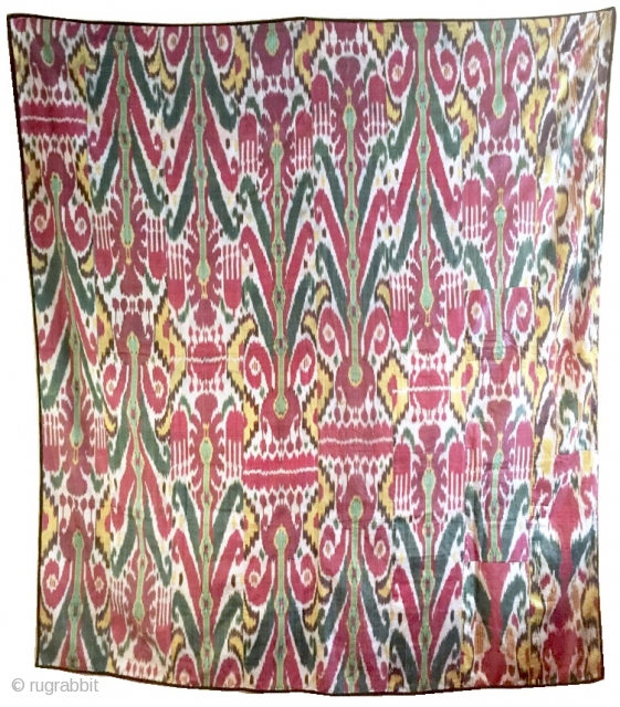 a Large antique Uzbek silk Adras Ikat dating to the 19th century Bulhara or khorezm. The magnificent wall Hanging is an older silk warp cotton weft Ikat. The archaic design of repeating  ...