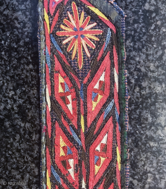 A beautiful antique Tekke Turkoman / Turkmen chyrpy or coat silk embroidered collar. It dates to the 19th century and it is an exceptional demonstration of the coveted Tekke tribe's embroidery art.  ...