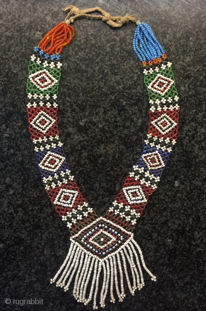 a fine antique glass bead woven Central Asian necklace from Nuristan region of Afghanistan. Ethnographic arts of Nuristan (be it textiles, jewellery or wood artefacts) are very distinct in comparison to other  ...